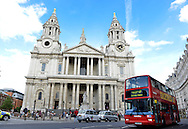 A double decker bus drives by St. Paul's Cathedral on August 14, 2012 in London .