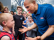 27 MAY 2019 - URBANDALE, IOWA: US Senator CORY BOOKER (D-NJ) talks to a child at a Memorial Day barbecue he hosted at his Iowa campaign headquarters. Sen. Booker is running to be the Democratic nominee for the US Presidency. Iowa traditionally hosts the the first selection event of the presidential election cycle. The Iowa Caucuses will be on Feb. 3, 2020.                  PHOTO BY JACK KURTZ