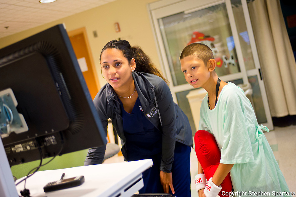 Pediatric heart specialist team works with 9 yr. old patient.