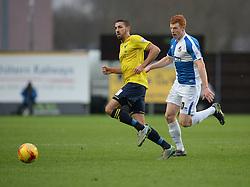 Rory Gaffney of Bristol Rovers puts pressure on Liam Sercombe of Oxford United - Mandatory byline: Alex James/JMP - 17/01/2016 - FOOTBALL - The Kassam Stadium - Oxford, England - Oxford United v Bristol Rovers - Sky Bet League Two