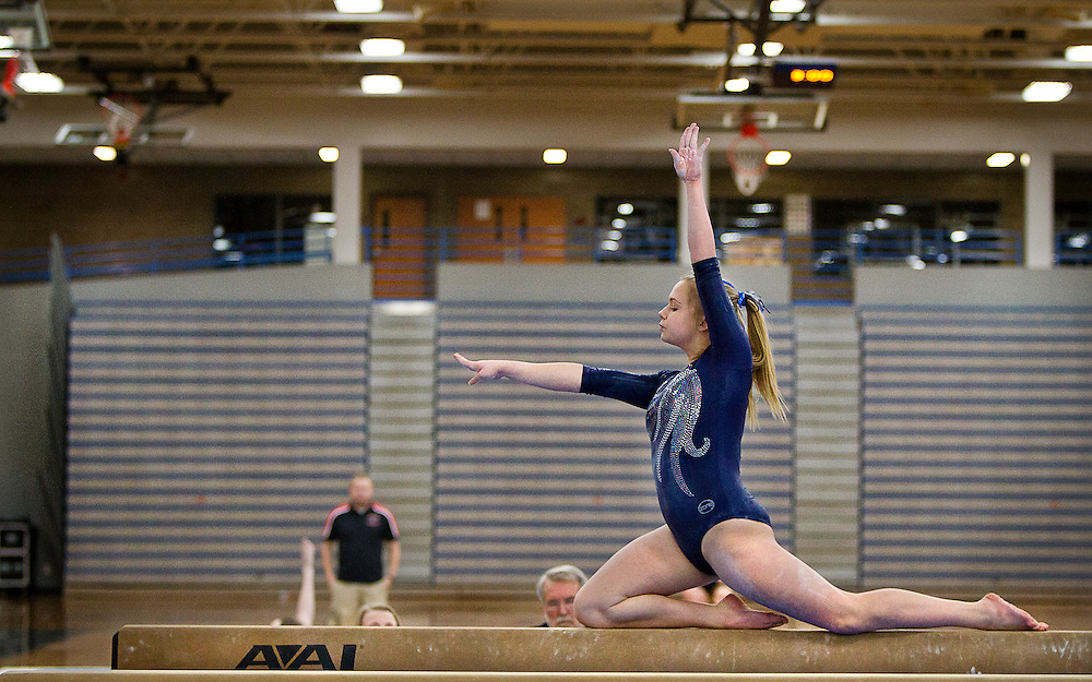 Champlin Park freshman Liz Hammond performs her balance beam routine during the dual gymnastics meet against Coon Rapids High School at Champlin Park, Friday, January 31, 2014. Champlin Park won the meet with a combined score of 137.35 over Coon Rapids' 125.975.