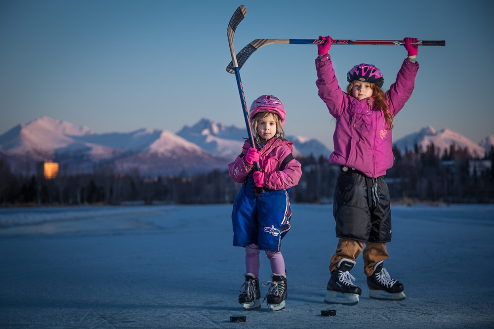 "Sisters Kavina (5) and Zakara (8) at Westchester Lagoon, Anchorage.  ""With the lack of snow this year, we needed to find an alternative to downhill skiing.  So, to get the girls out of the house, we started skating.  They love it!""  -John Baumeister"