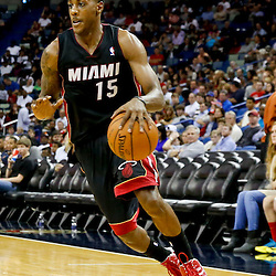 Oct 23, 2013; New Orleans, LA, USA; Miami Heat point guard Mario Chalmers (15) against the New Orleans Pelicans during the second half of a preseason game at New Orleans Arena. The Heat defeated the Pelicans 108-95. Mandatory Credit: Derick E. Hingle-USA TODAY Sports