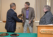 Ohio University President Roderick McDavis and Executive Vice President and Provost Pam Benoit congratulate Brian Hoyt during the Presidential Teacher Awards in the Multicultural Center on Sept. 23, 2014. Photo by Lauren Pond
