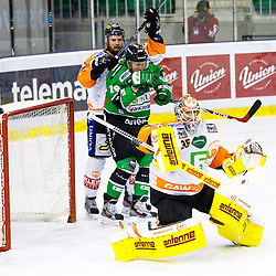 31.10.2014, Hala Tivoli, Ljubljana, SLO, EBEL, HDD Telemach Olimpija Ljubljana vs Moser Medical Graz 99ers, 15. Runde, in picture Danny Sabourin (Moser Medical Graz 99ers, #35) with a save during the Erste Bank Icehockey League 15. Round between HDD Telemach Olimpija Ljubljana and  Moser Medical Graz 99ers at the Hala Tivoli, Ljubljana, Slovenia on 2014/10/31. Photo by Matic Klansek Velej / Sportida