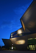Exterior images of the Denver Art Museum's Frederic C. Hamilton Building addition at dusk on Thursday September 14, 2006. The Denver Art Museum is an art museum in Denver, Colorado located in Denver's Civic Center. It is known for its collection of American Indian art, and has a comprehensive collection numbering more than 55,000 works from across the world. The completion and opening date of a major expansion, the Frederic C. Hamilton building, designed as a joint venture by Studio Daniel Libeskind and Brit Probst (Architect of Record) of Davis Partnership Architects. The new building opened on October 7, 2006, and is clad in titanium and glass..(MARC PISCOTTY/ © 2006)