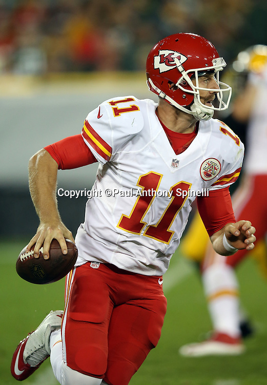 Kansas City Chiefs quarterback Alex Smith (11) rolls out while looking to pass in the second quarter during the 2015 NFL week 3 regular season football game against the Green Bay Packers on Monday, Sept. 28, 2015 in Green Bay, Wis. The Packers won the game 38-28. (©Paul Anthony Spinelli)