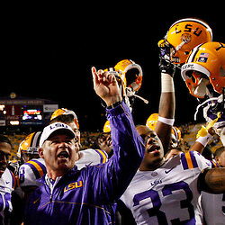November 10, 2012; Baton Rouge, LA, USA;  LSU Tigers head coach Les Miles celebrates with his team following a win over the Mississippi State Bulldogs in a game at Tiger Stadium.  LSU defeated Mississippi State 37-17. Mandatory Credit: Derick E. Hingle-US PRESSWIRE