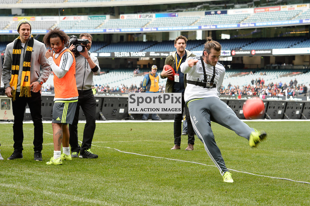 MARCELO VIEIRA DA SILVA looks on as team mate GARETH BALE attempt a kick of an AFL ball at Real Madrid open training session at the Melbourne Cricket Ground, 17th July 2015 at an open training session for over 10,000 fans in the lead up to the International Champions Cup game against A.S. Roma.  Melbourne Australia. © Mark Avellino | SportPix.org.uk