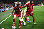 Liverpool midfielder James Milner (7) and Liverpool midfielder Georginio Wijnaldum (5) look round as the referee blows the whistle for the end of the Champions League semi-final, leg 2 of 2 match between Liverpool and Barcelona at Anfield, Liverpool, England on 7 May 2019.