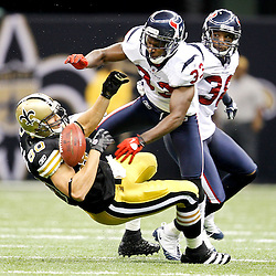 September 25, 2011; New Orleans, LA, USA; Houston Texans safety Troy Nolan (33) hits a breaks up a pass intended for New Orleans Saints tight end Jimmy Graham (80) during the fourth quarter at the Louisiana Superdome. The Saints defeated the Texans 40-33. Mandatory Credit: Derick E. Hingle