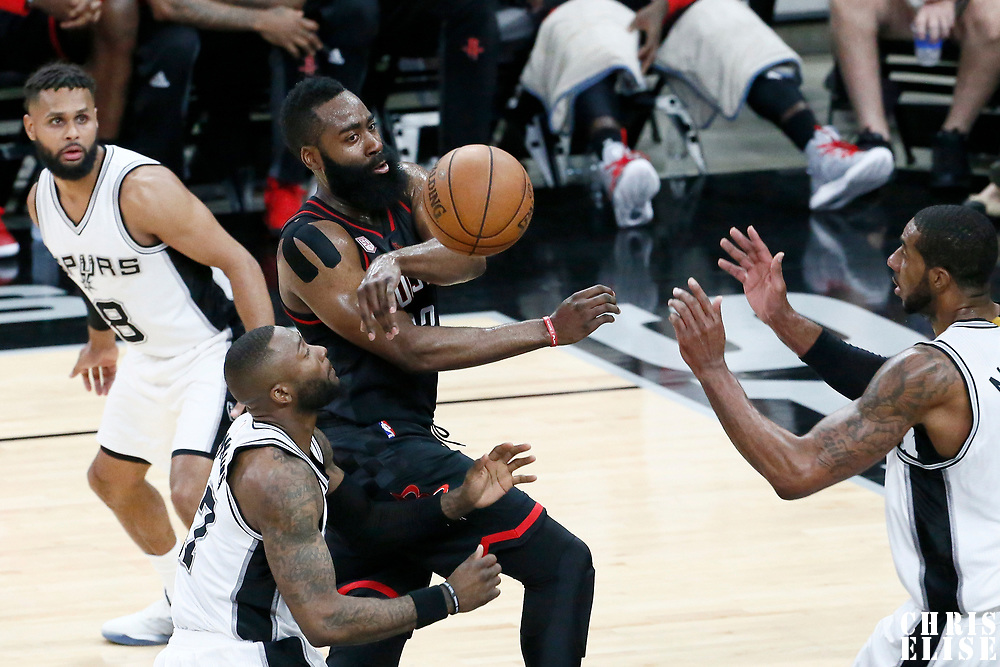 03 May 2017: Houston Rockets guard James Harden (13) passes the ball past San Antonio Spurs guard Jonathon Simmons (17) and San Antonio Spurs forward LaMarcus Aldridge (12) during the San Antonio Spurs 121-96 victory over the Houston Rockets, in game 2 of the Western Conference Semi Finals, at the AT&T Center, San Antonio, Texas, USA.