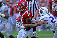 Wolfpack running back Reggie Gallaspy (11) heads up field for a first down against JMU.