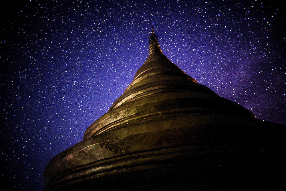 Shwetaung Paya, or the Golden Hill Pagoda is haloed by a starry night in Mrauk U, Myanmar.
