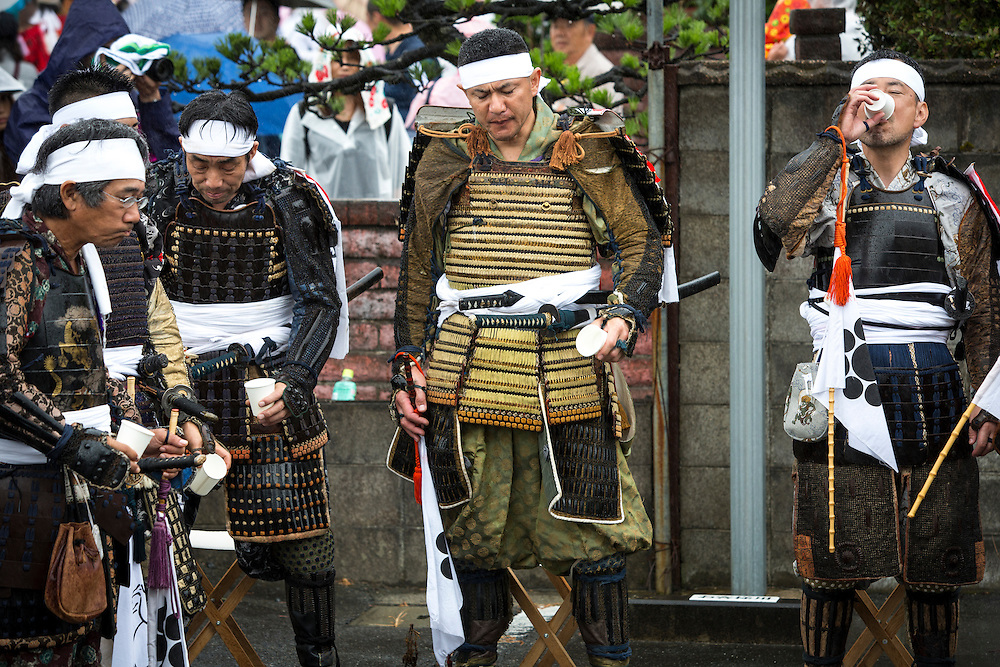 "MINAMISOMA, JAPAN - JULY 24 :  A samurai men drink sake as they prepare for the battle race during the ""Hon Matsuri"", Soma Nomaoi festival at Hibarigahara field on Sunday, July 24, 2016 in Minamisoma, Fukushima Prefecture, Japan. ""Soma-Nomaoi"" is a three day traditional festival that recreates a samurai battle scene from more than 1,000 years ago. The festival has gathered more than thousands visitors as Fukushima still continues to recovery from the 2011 nuclear disaster, the samurai warriors battles for recovery of the area. (Photo: Richard Atrero de Guzman/NURPhoto)"