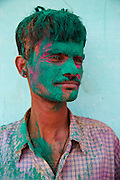 Man covered in green paint powder during the festival of Holi in the city of Jaipur, Rajasthan, India.