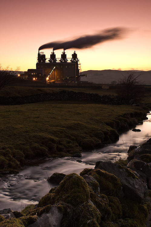 Smoke discharge from the Corus plant, Shap lime works, on the edge of the Lake District National Park, at sunset, Cumbria, Uk