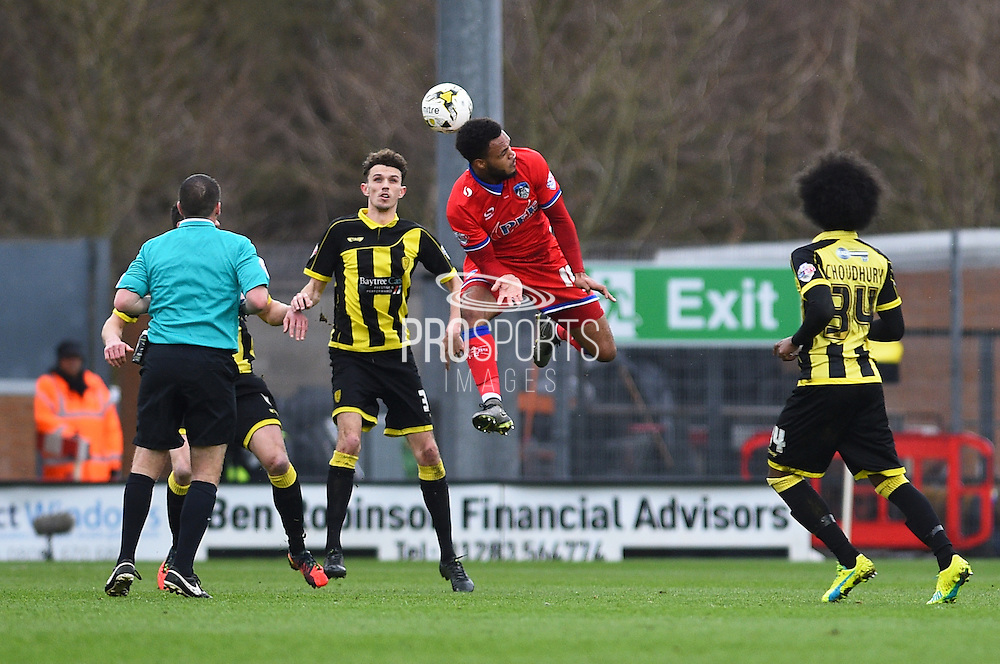 Oldham Athletic forward Aaron Amadi-Holloway heads the ball during the Sky Bet League 1 match between Burton Albion and Oldham Athletic at the Pirelli Stadium, Burton upon Trent, England on 26 March 2016. Photo by Jon Hobley.