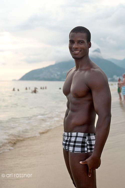 Portrait of gay black Brazilian man on Ipanema beach.<br /> Posto 8 Ipanema