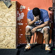 A crossfit student feeling exhausted after completing his one-hour round.