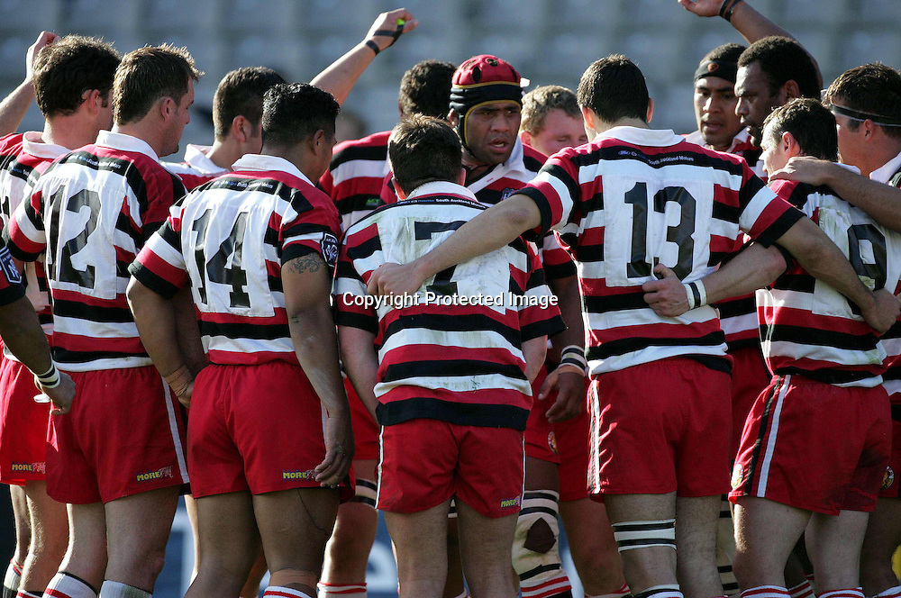 Counties team come together for a team talk during the Ranfurly Shield match between Auckland and Counties Manukau at Eden Park Auckland on 1 August 2004.<br />Auckland beat Counties Manukau 100-15<br />Please credit: Andrew Cornaga/PHOTOSPORT
