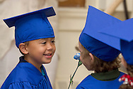 New Windsor, New York - A young boy talks to another child as Hudson Hills Academy held its Primary School graduation ceremony on Wednesday, June 11, 2014. The children completed a Montessori program at the school. ©Tom Bushey / The Image Works