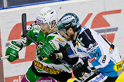 Ales Music (HDD Tilia Olimpija, #16) vs Curtis Murphy (EHC Liwest Linz, #41) during ice-hockey match between HDD Tilia Olimpija and EHC Liwest Black Wings Linz at fourth match in Semifinal  of EBEL league, on March 13, 2012 at Hala Tivoli, Ljubljana, Slovenia. (Photo By Matic Klansek Velej / Sportida)