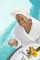 Woman Enjoying a Fresh Meal at the Spa