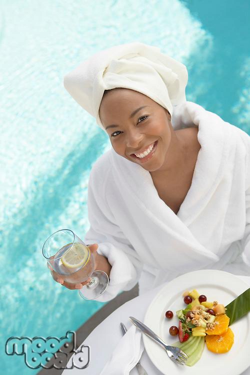 Woman Enjoying a Fresh Meal at the Spa