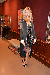 TAMSIN EGERTON at the opening of the exhibition 'My Mother Was A Reeler' at Etro, 43 Old Bond Street, London on 5th October 2016.