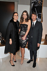 Left to right, Valentino designer MARIA GRAZIA CHIURI, ELIZABETH HURLEY and Valentiono designer PIER PAOLO PICCIOLI at a private view of 'Valentino: Master Of Couture' at Somerset House, London on 28th November 2012.