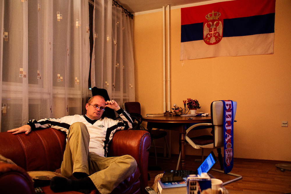 Norwegian writer Kristian Kahrs at home alone in his Belgrade apartment after his football team played their penultimate game of the year. Rosenborg lost 0-1 to Fredrickstad, and Kahrs was continually checking the internet for the results in other league matches...Photographed for Plot Magazine.