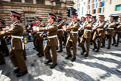 The 1st Battalion Scots Guards paraded down the Royal Mile today after receiving the Freedom of the City of Edinburgh to celebrate their return from a tour of duty in Afghanistan.<br /> &copy;Michael Schofield.