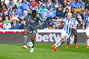 Wilfred Ndidi of Leicester City (25) and Aaron Mooy of Huddersfield Town (10) in action during the Premier League match between Huddersfield Town and Leicester City at the John Smiths Stadium, Huddersfield, England on 6 April 2019.