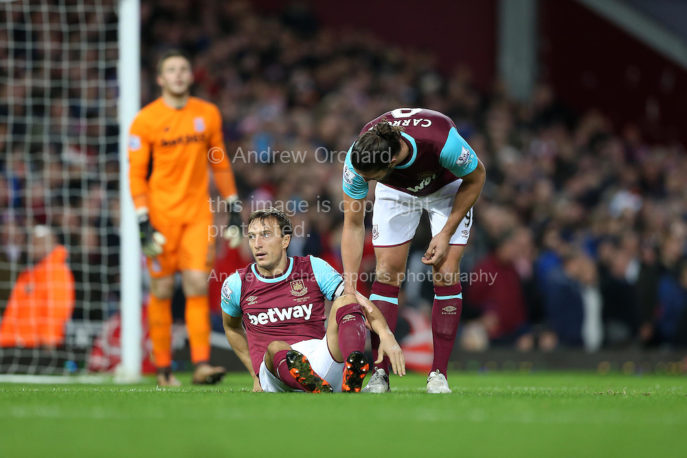 Mark Noble of West Ham United (on ground) reacts as he is not awarded a penalty for being held down by Ryan Shawcross, the Stoke City captain in the penalty area .Barclays Premier league match, West Ham Utd v Stoke city at the Boleyn Ground, Upton Park  in London on Saturday 12th December 2015.<br /> pic by John Patrick Fletcher, Andrew Orchard sports photography.