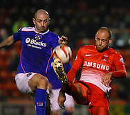 Scott Cuthbert of Leyton Orient (right) and Gary Harkins of Oldham Athletic challenge for the ball during the Sky Bet League 1 match at the Matchroom Stadium, London<br /> Picture by David Horn/Focus Images Ltd +44 7545 970036<br /> 25/03/2014