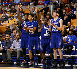 Fairmont Senior's bench celebrates as their team starts to pull away against Bridgeport during a semi final round game at the Charleston Civic Center.