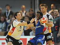 Handball EM Herren 2010 Hauptrunde Deutschland - Frankreich 24.01.2010 Torsten Jansen (links) und Michael Kraus (rechts beide GER) gegen Luc Abalo (FRA Mitte)