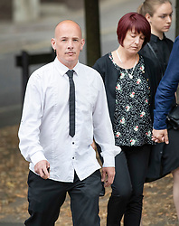 © Licensed to London News Pictures. 18/07/2018. Woking, UK.  The family of Private (Pte) Sean Benton arrive at Woking Coroner's Court.  Pte Benton's sister Tracy Lewis (C) and twin brother Tony Benton (L) will hear the coroner read out his full ruling today. Pte Sean Benton was found with five gunshot wounds to his chest at Deepcut army base in 1995. Photo credit: Peter Macdiarmid/LNP