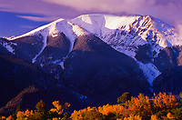 First snow of the autumn season covers 13,297 ft. Mount Herard of the Sangre De Cristo Mountains.  Great Sand Dunes National Park, Colorado.