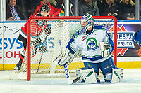 KELOWNA, BC - OCTOBER 16:  Isaac Poulter #1 of the Swift Current Broncos watches the rebound after making a save on a shot by Pavel Novak #11 of the Kelowna Rockets at Prospera Place on October 16, 2019 in Kelowna, Canada. (Photo by Marissa Baecker/Shoot the Breeze)