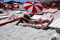 topless woman on the beach, Deauville, Normandy, France