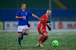 CESENA, ITALY - Tuesday, January 22, 2019: Wales' Jessica Fishlock, wearing a protective face mask, and Italy's Aurora Galli during the International Friendly between Italy and Wales at the Stadio Dino Manuzzi. (Pic by David Rawcliffe/Propaganda)