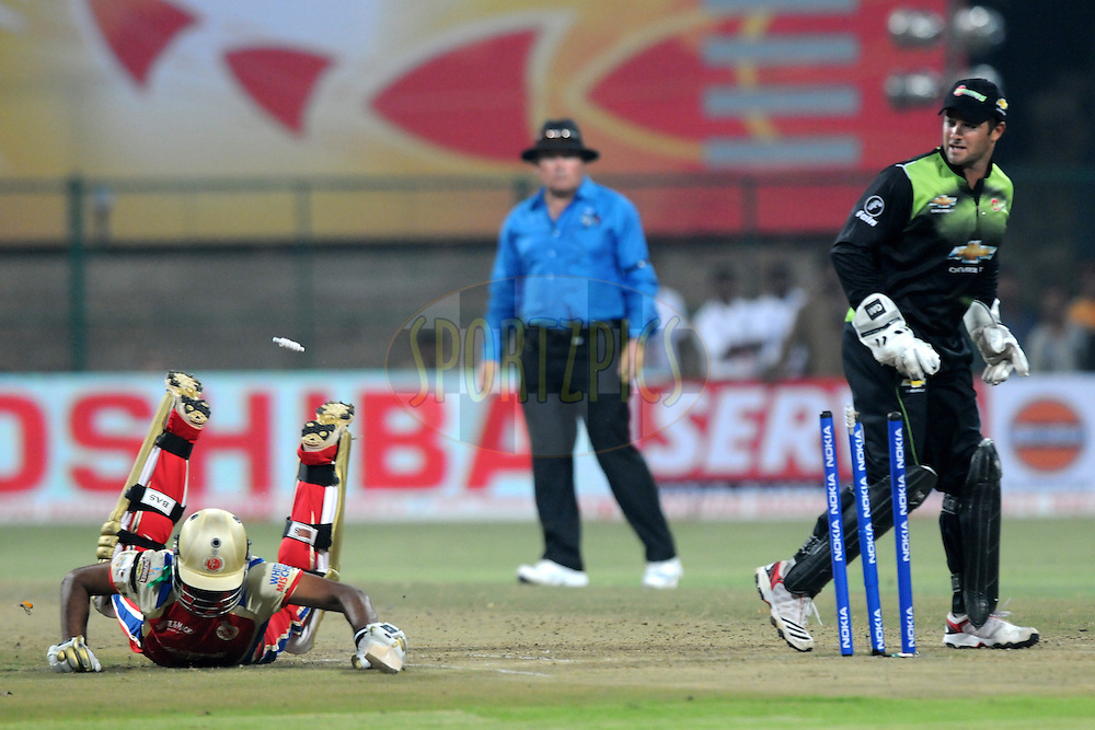 Sreenath Aravind of Royal Challengers Bangalore slides to make it  during match 1 of the NOKIA Champions League T20 ( CLT20 )between the Royal Challengers Bangalore and the Warriors held at the  M.Chinnaswamy Stadium in Bangalore , Karnataka, India on the 23rd September 2011..Photo by Pal Pillai/BCCI/SPORTZPICS