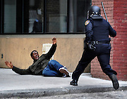 "A man screams ""Hands up!!"" after being chased by a police officer in downtown Baltimore near Lexington Market. The man, who police suspected of looting and property damage, was running from police before he fell and was arrested. The looting and unrest April 27, 2015 followed the burial of Freddie Gray, who died while in police custody. Six officers were indicted in the case and trials are currently underway."