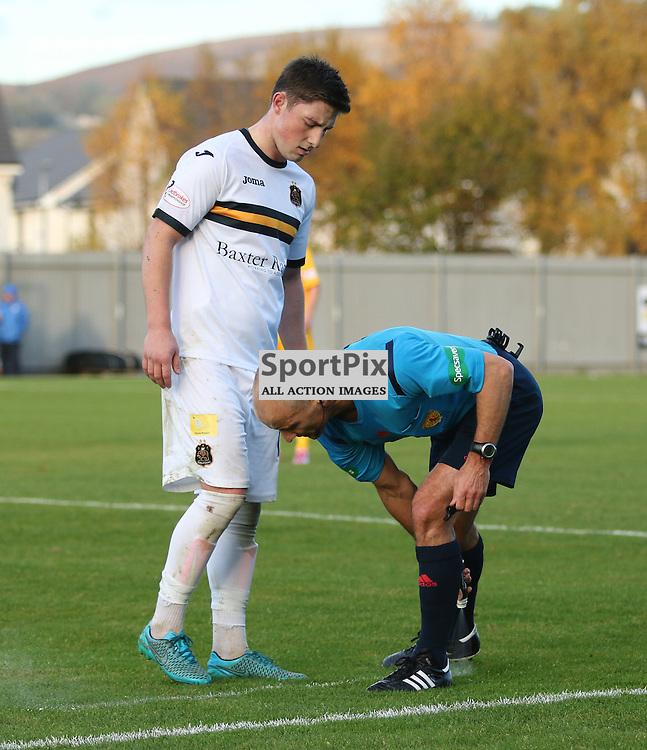 Jordan Kirkpatrick stands behind the sprayed line during the Dumbarton FC v Morton FC Scottish Championship 31 October 2015 <br /> <br /> (c) Andy Scott | SportPix.org.uk