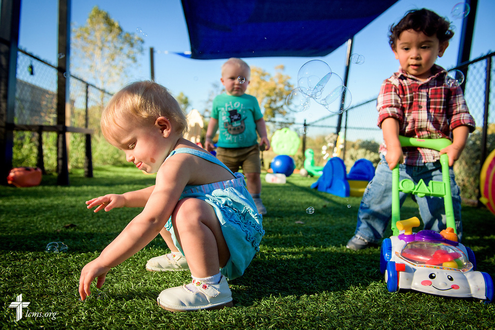 (L-R) Aleah, Zayden, and Xavier play outside together under the watchful eye of Laurie Harkey at ACTS of Love Early Childhood Education Center on Tuesday, Nov. 15, 2016, in Leander, Texas. LCMS Communications/Erik M. Lunsford