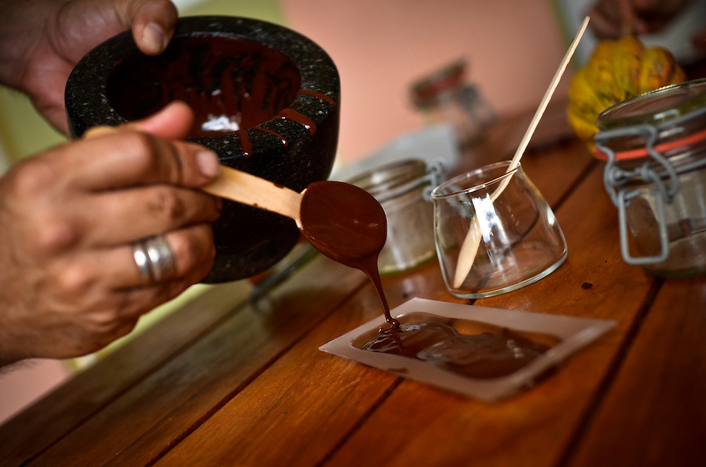 "Tourists learn to make chocolate during a ""Bean to Bar"" class at Hotel Chocolat on the Rabot Estate in St. Lucia, taught by Chef Ron Lafeuille, who might as well have Ph.D. in cocoa and can thus drop every name in the storied history of the fruit, from colonizers to Cadbury."