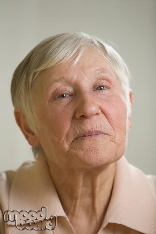 Portrait of elderly woman with short grey hair