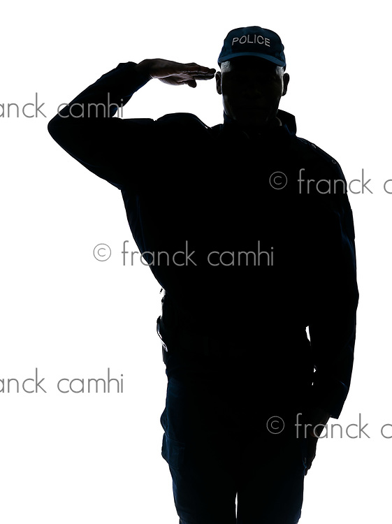 Silhouette one policeman saluting in studio on white isolated background